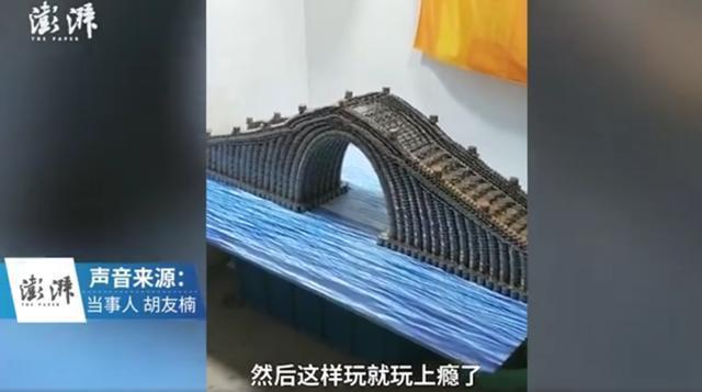 男子用5万枚硬币堆出上海地标 耗时半月堆出2米高扭转式大楼