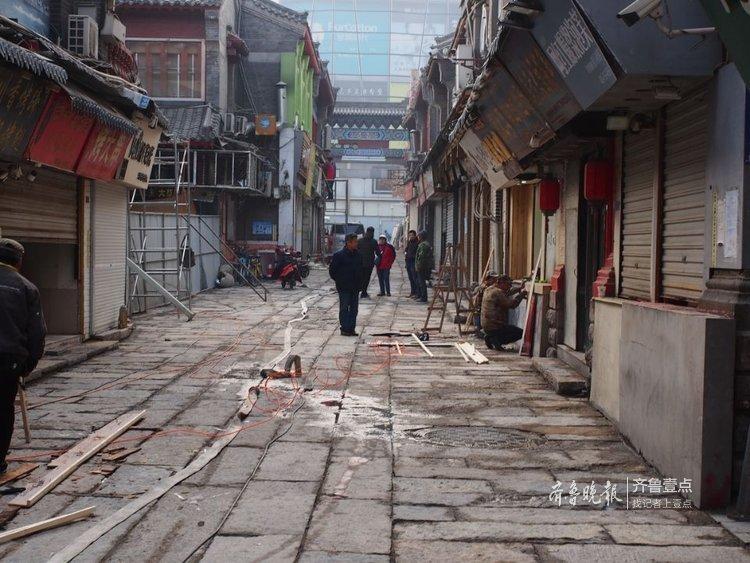 围观!济南芙蓉街主街石板铺完了